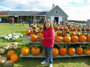 Posing with a pumpkin