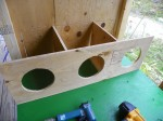 Three nesting boxes framed in