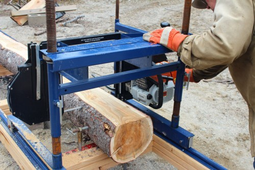 making a cut with the portable sawmill