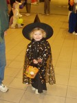 a little witch at Halloween